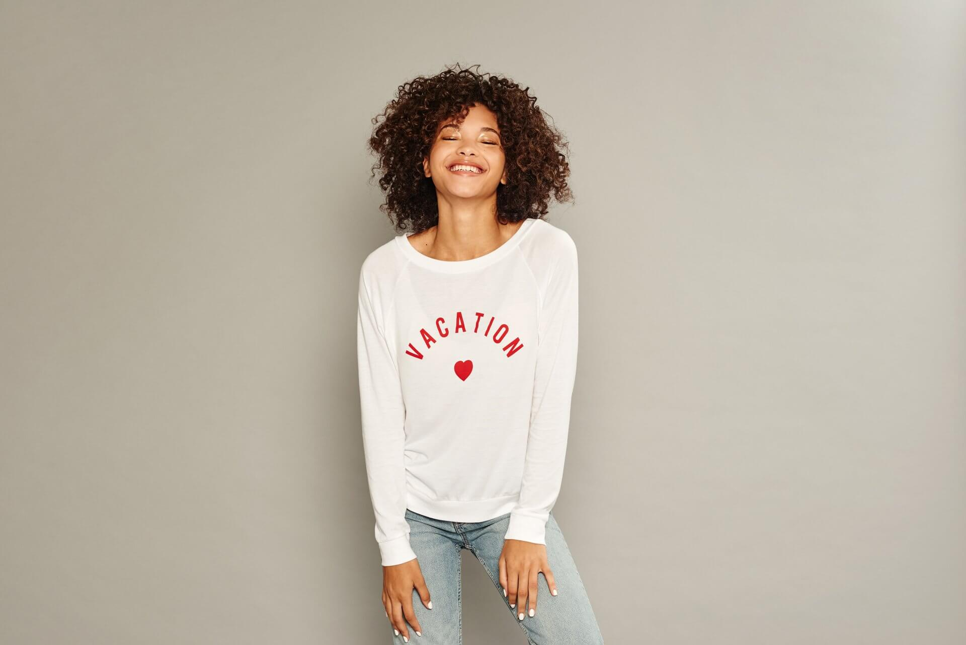 White sweatshirt with red 'Vacation'
