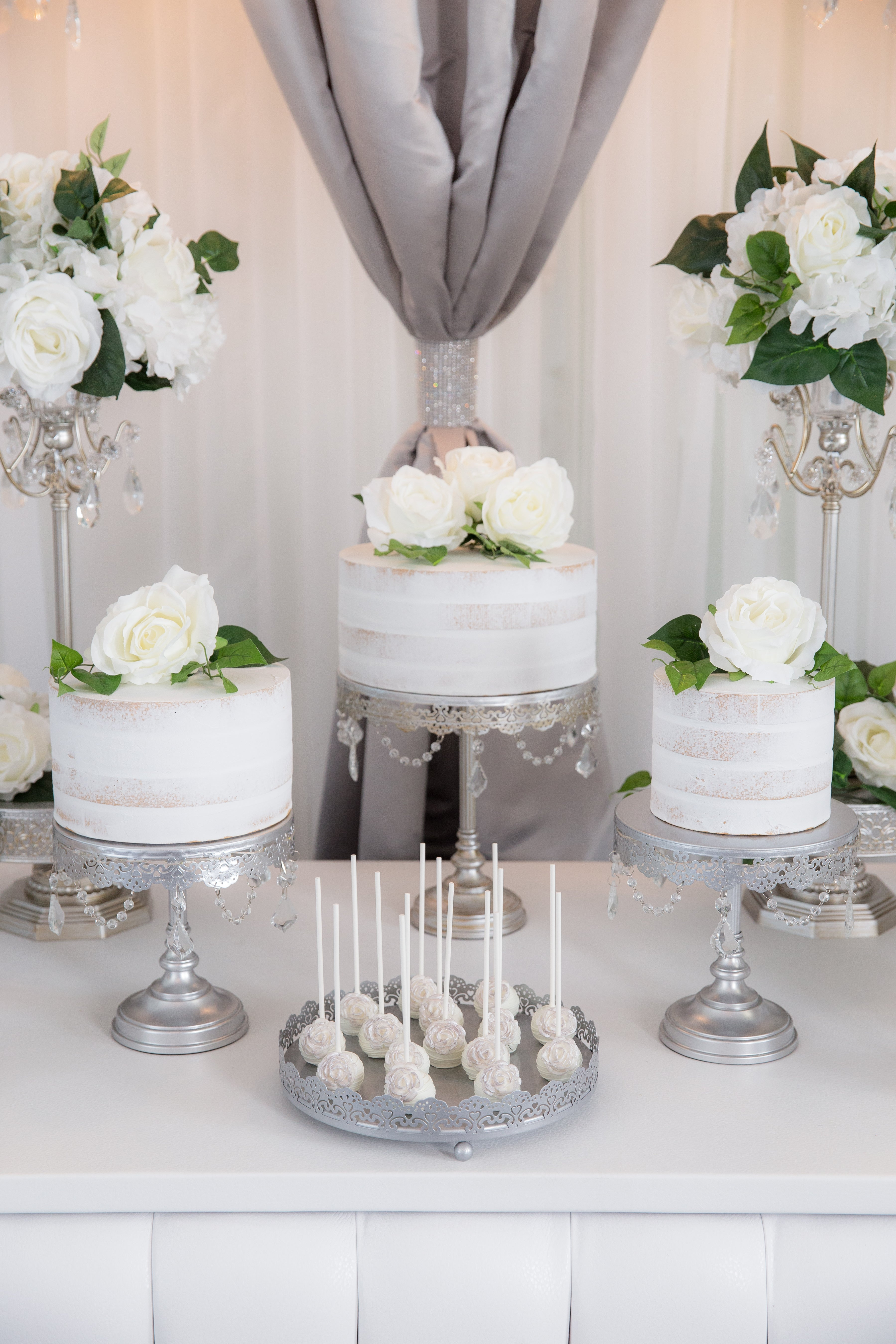 Garden Theme wedding naked cake with cake pops on a dessert table with cake stands by Amalfi Decor