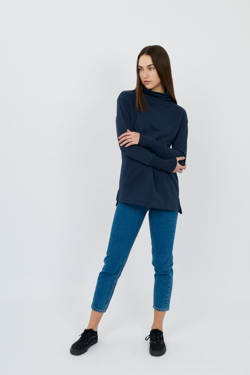 <p>Never underestimate the power of everyday ease. As all-purpose as baker's flour and as comforting as that first sip of caffeinated brew, this elegant loopback terry tunic will stir a little sweet sophistication into any style.</p>