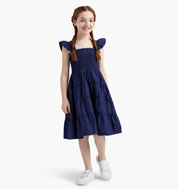Talia wears a size 7-8Y in the Navy color:navy