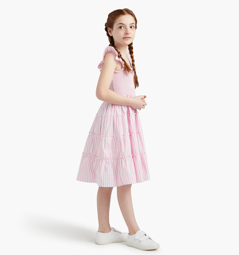 Talia wears a size 7-8Y in the Bubblegum Stripe