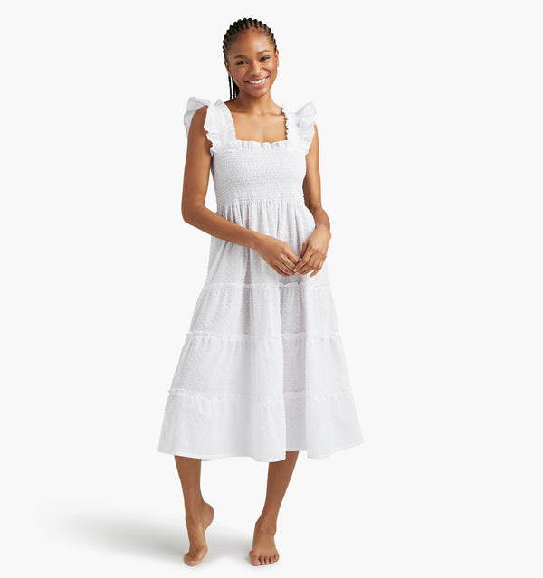 "Na'Jeen is 5'9"" and wears a size XS in the White Semi-Sheer Swiss Dot color:white semi-sheer swiss dot"