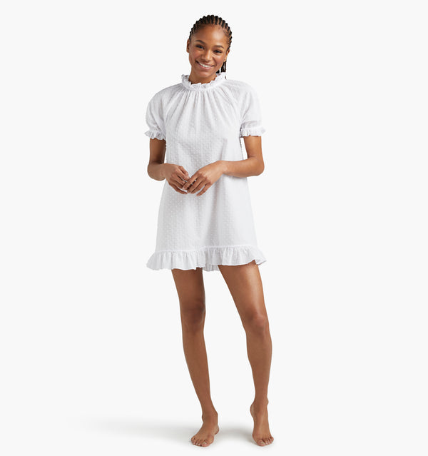 "Na'Jeen is 5'9"" and wears a size XS in the Sheer White Swiss Dot color:Sheer White Swiss Dot"