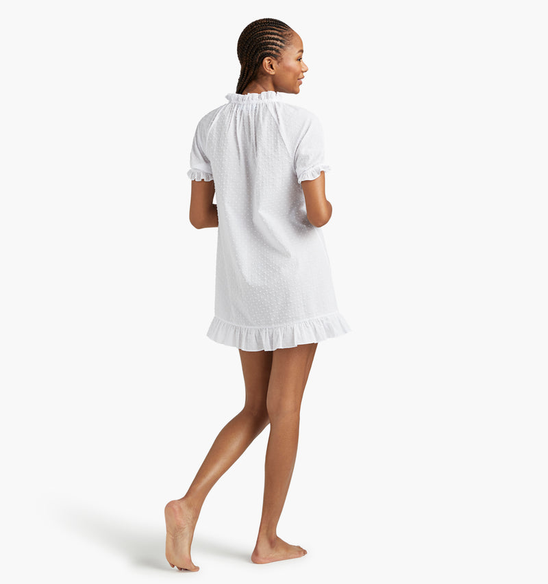 "Na'Jeen is 5'9"" and wears a size XS in the White Semi-Sheer Swiss Dot"