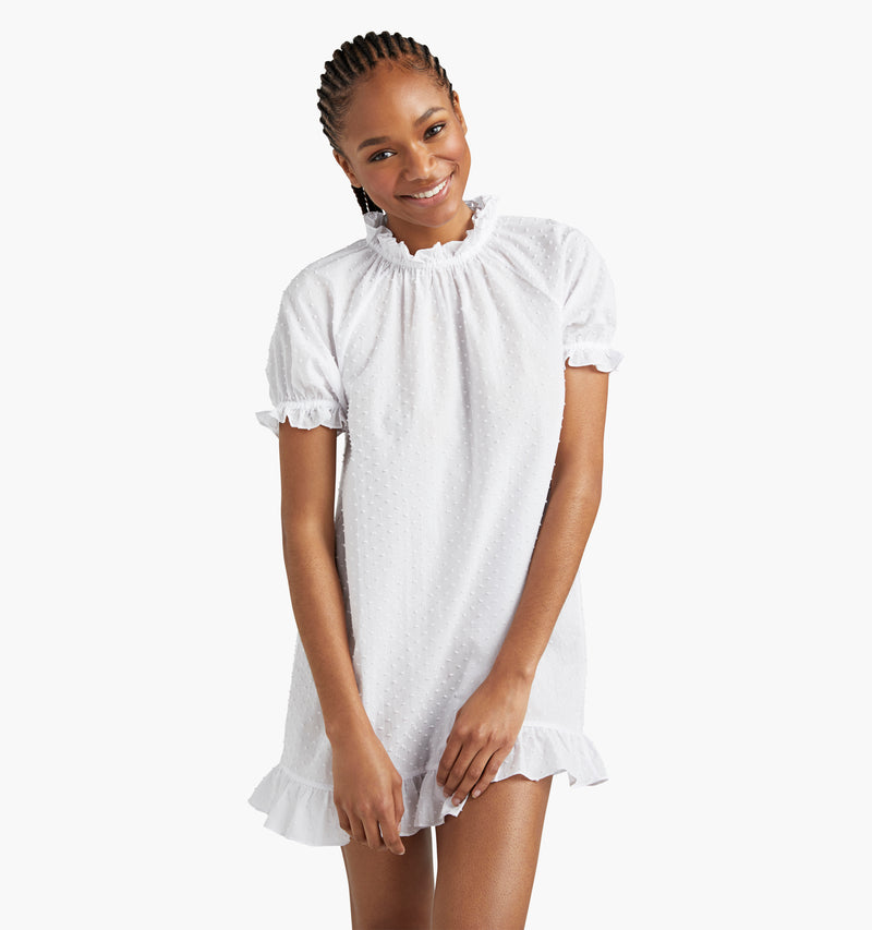 "Na'Jeen is 5'9"" and wears a size XS in the Sheer White Swiss Dot"
