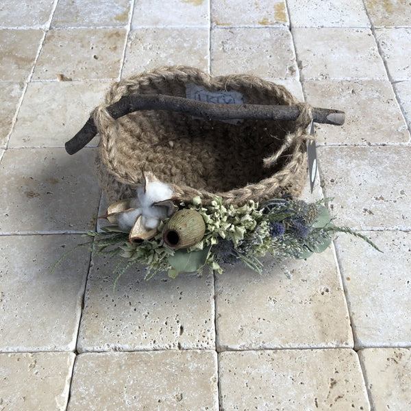 Small basket with branch handle