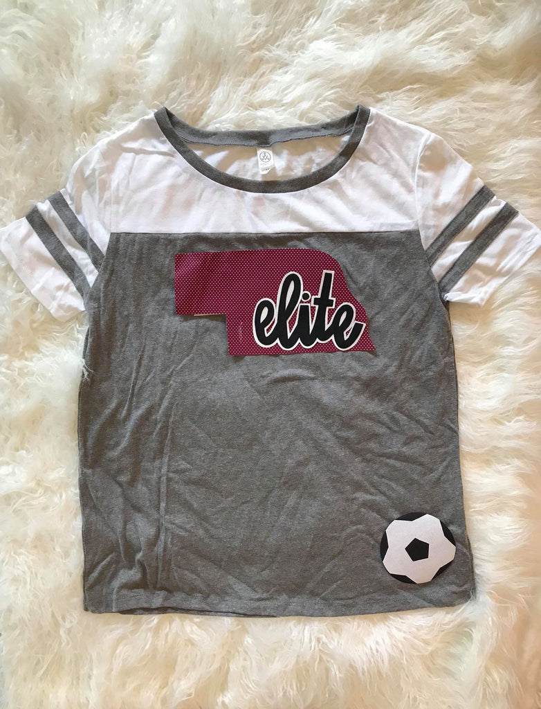 NE ELITE AND SOCCER BALL STADIUM TEE