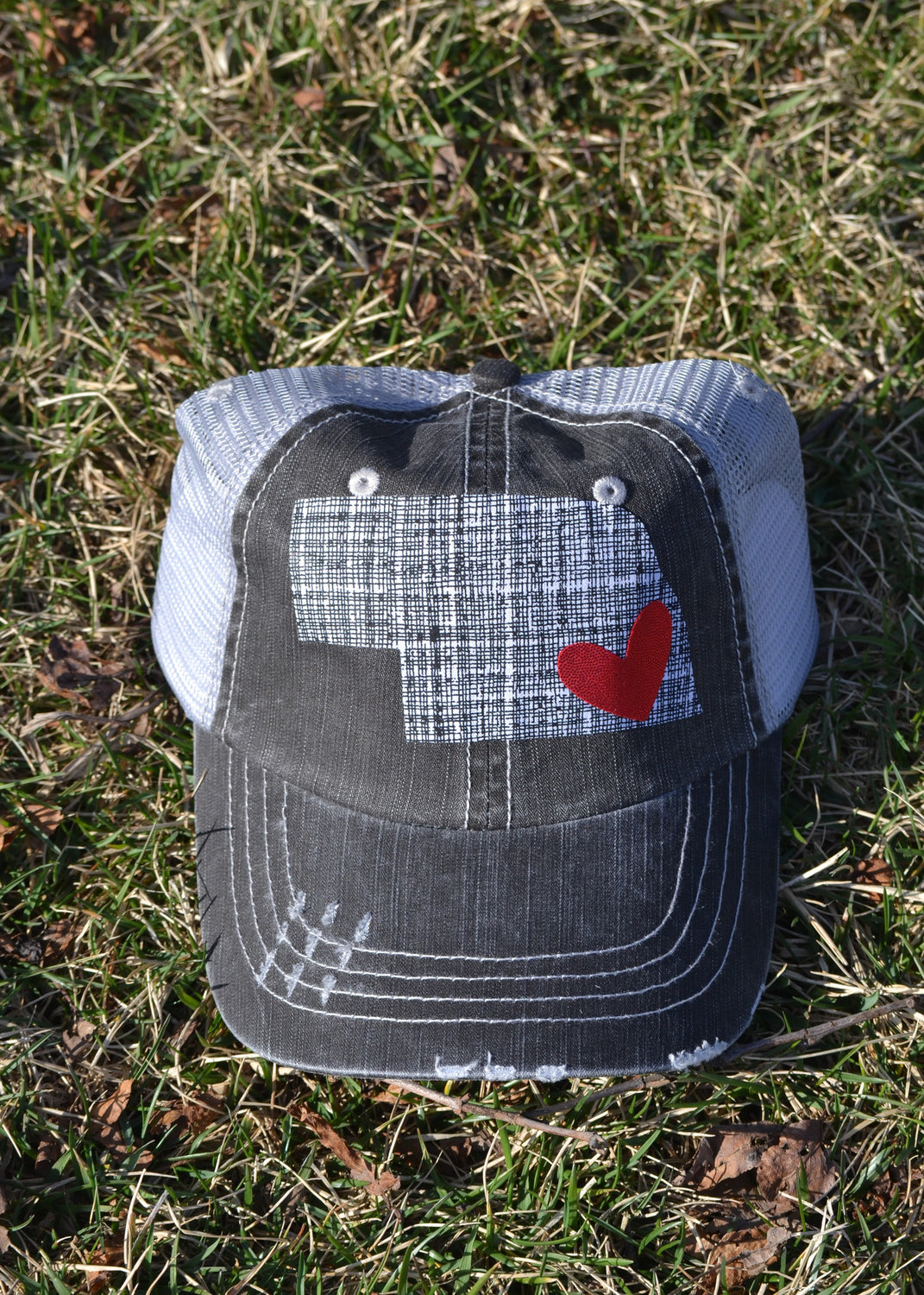 TRUCKER HAT WITH BLACK GRAPHITE STATE AND RED HEART