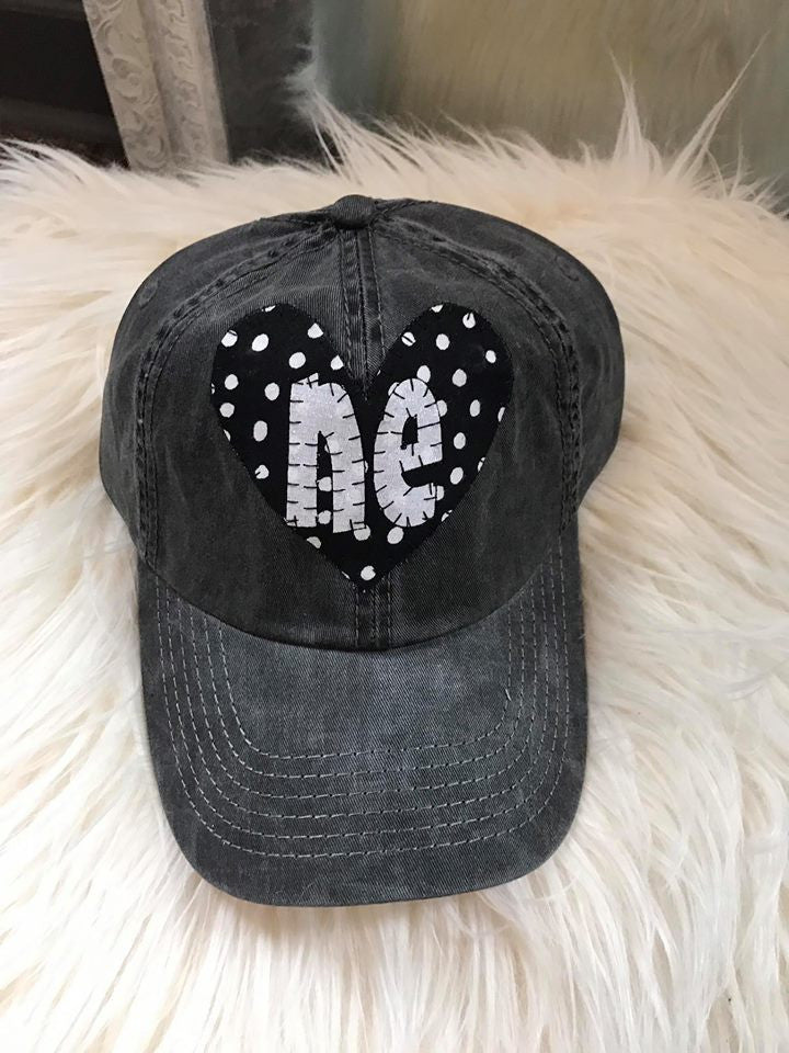 "DISTRESSED HAT- BLACK/ WHITE POLKA HEART WITH WHITE ""NE"""