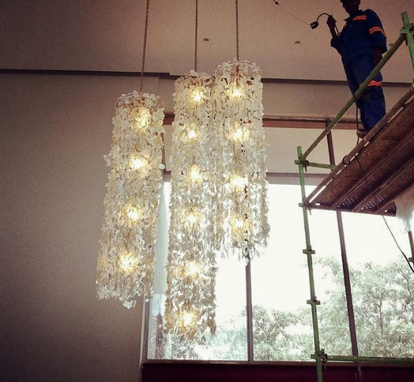 "LIGHTING - STEPHEN PIKUS ""FIRE+ICE"" RECYCLED GLASS CHANDELIERS"