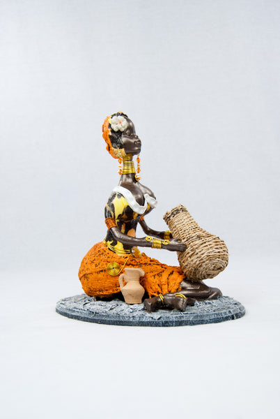 Reinaldo Mendez Sitting w/ Basket Orange Mustard African Doll