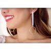 Jenn Im wearing Edie Hoops earrings by Jenny Bird in Gold
