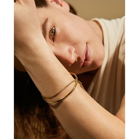 Gold adjustable Sadie Bangle bracelet by Jenny Bird