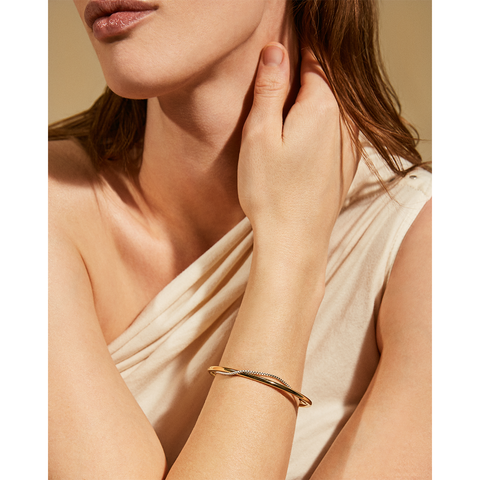 Gold and silver adjustable Sadie Bangle bracelet by Jenny Bird