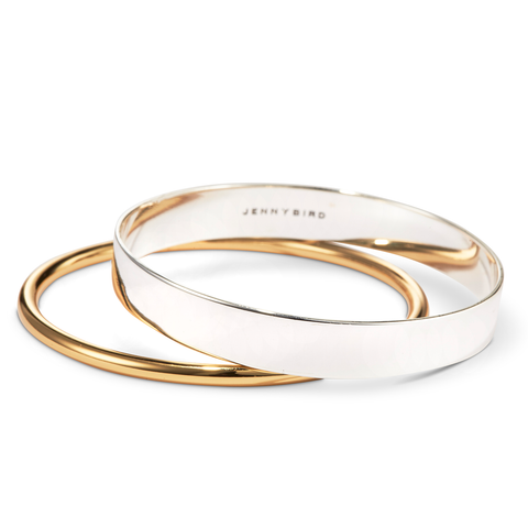 Gold and silver Uma bangle set by Jenny Bird