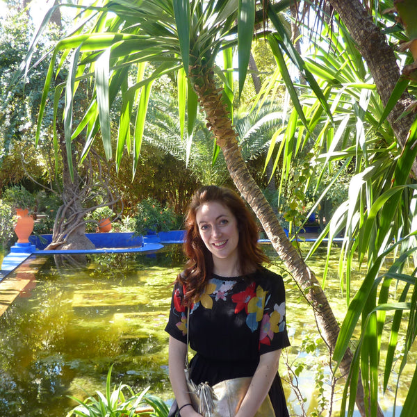Sitting by the water in Marjorelle Gardens