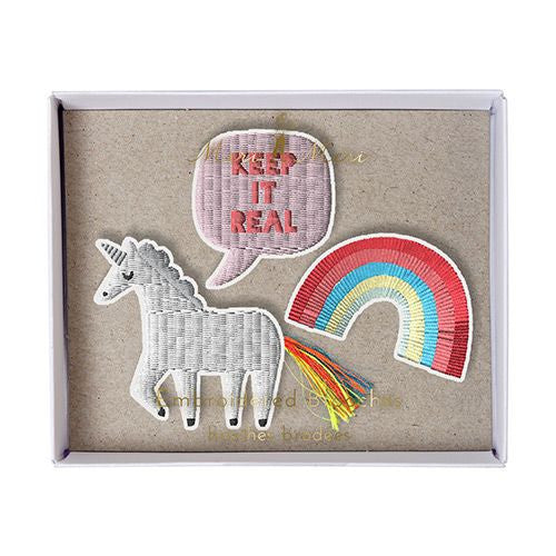 unicorn badge and rainbow brooches