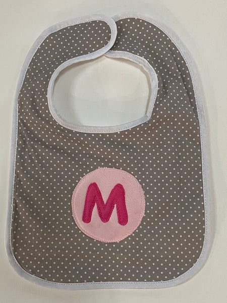 Tiny dot bib with hot pink initial and light pink circle