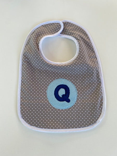Tiny dot bib with navy blue initial and light blue circle