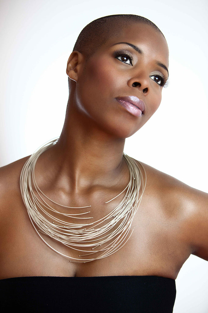 The sterling silver 16 line African necklace on model Sidra Smith.