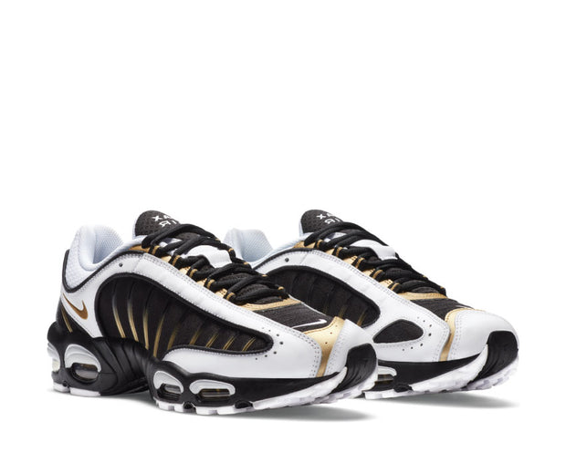 https://cdn.shopify.com/s/files/1/0933/1060/products/nike-air-max-tailwind-iv-black-2-metallic-gold-white-ct1284-001_620x.jpg