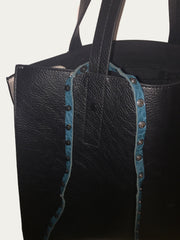 Drape STYLESTRING around your strap/handle or hardware with the decorative side facing forward.