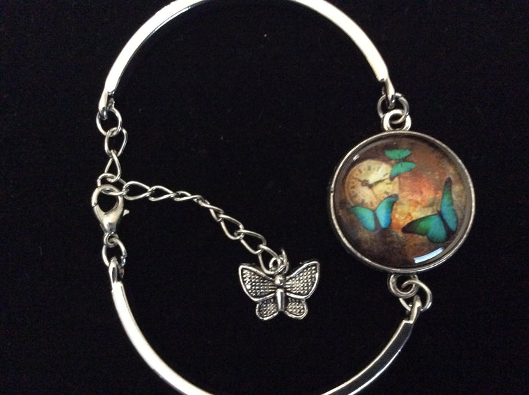 Butterfly Watch Glass Domed Charm on a Silver Adjustable Cuff Bracelet Bangle