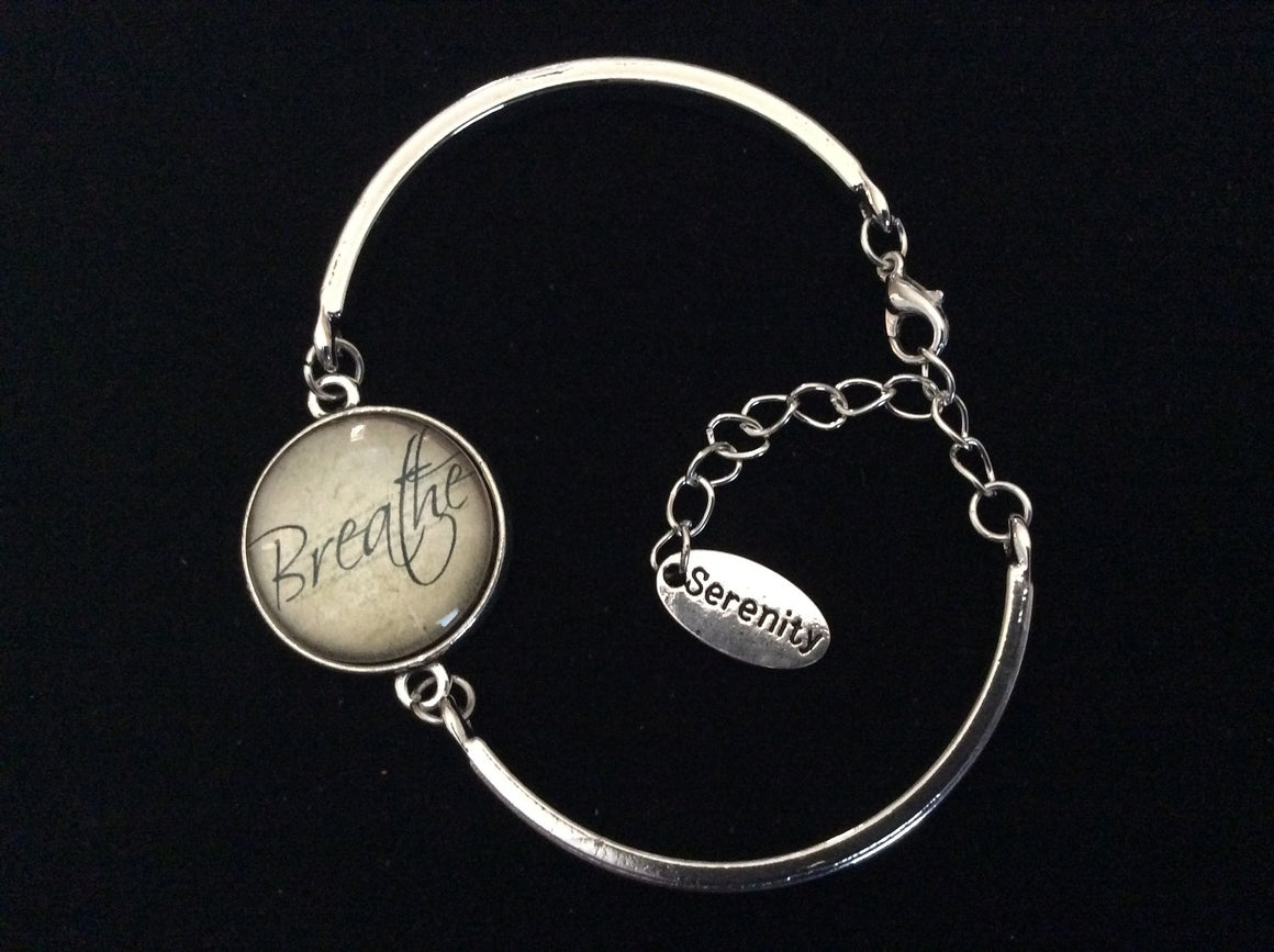 Breathe in Serenity Glass Domed Charm and Silver Stamped Serenity Tag Charm on a Silver Adjustable Cuff Bracelet