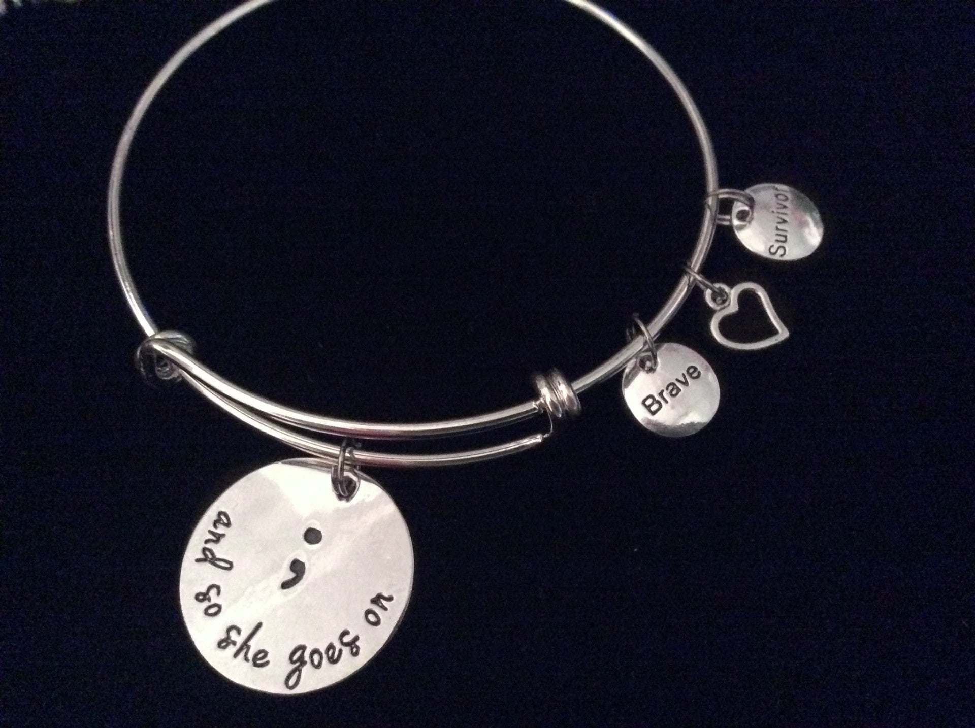 Expandable charm bracelets tagged inspirational and word quotes brave survivor and so she goes on semicolon expandable silver charm bracelet adjustable wire bangle inspirational biocorpaavc Choice Image