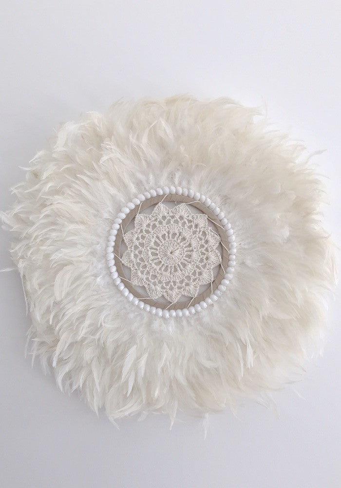 round white feather and shell wall art