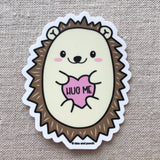 Cute hedgehog sticker says hug me on fabric