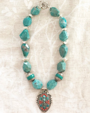 heather matjasic ohm jewelry shop naples ammonite turquoise tibetan turquoise coral necklace