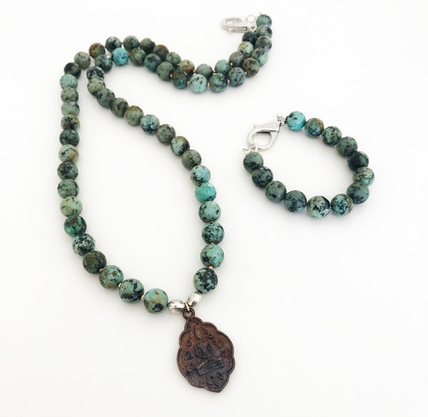 Heather Matjasic OHM Jewelry Shop african Turquoise buddha necklace naples florida