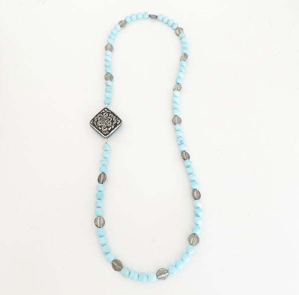 Heather Matjasic OHM Jewelry Shop Naples Florida necklace aqua agate tibetan endless knot african discs