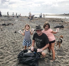 Legendary surfer Jim Banks comes to help out at Each Beach, Bali clean up.
