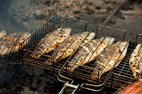 whole cooked fish in grilling rack