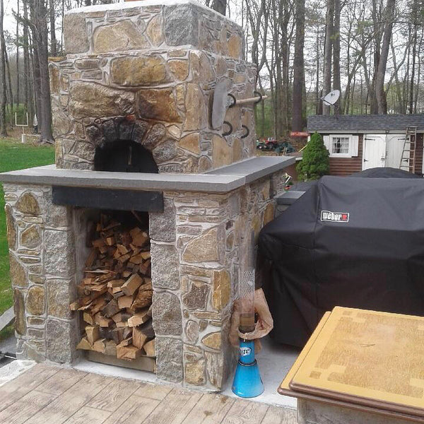 Wood fired oven with stocked firewood