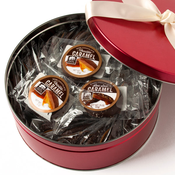 Classic chocolate covering copper kettle cooked caramel. Milk chocolate and dark chocolate with sea salt. Packaged in a beautiful red tin with a satin white ribbon.