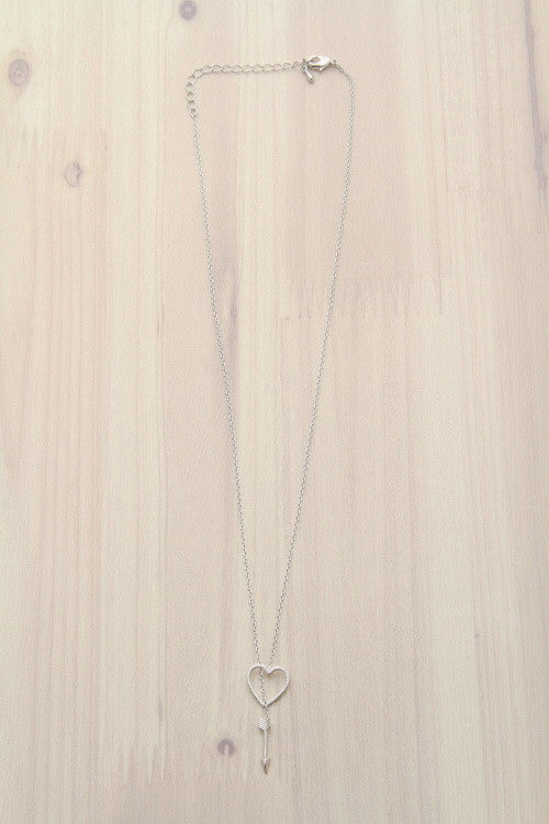 silver lariat necklace with heart and arrow