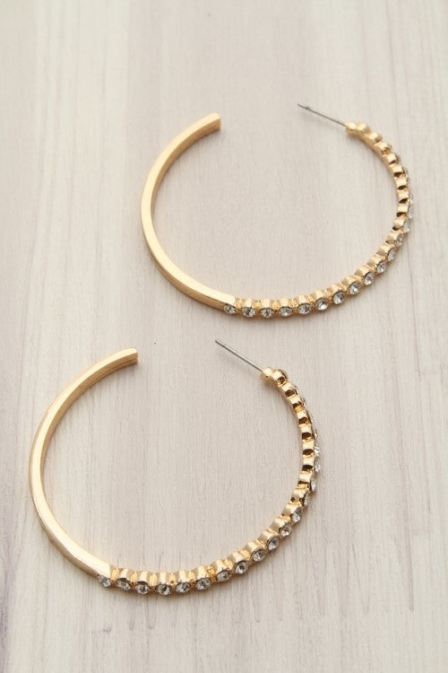 open-ended golden hoop earrings with rhinestones