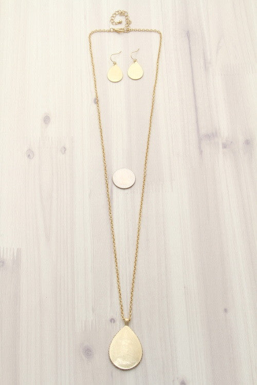 teardrop pendant necklace with rhinestones and matching earrings worn gold