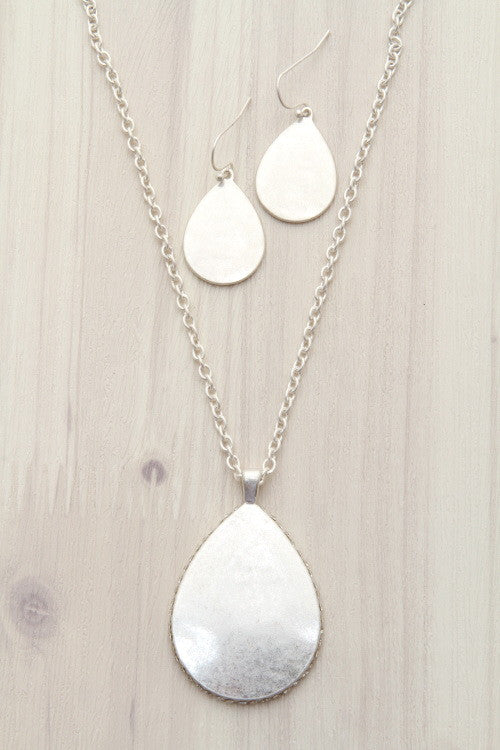 teardrop pendant necklace with rhinestones and matching earrings worn silver
