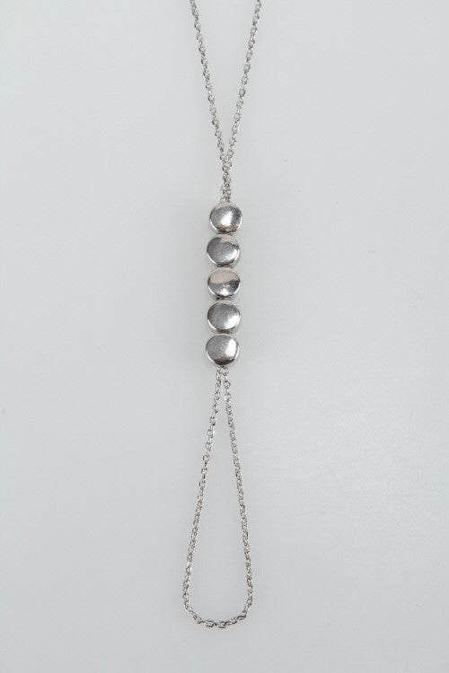 y chain necklace with circular link pendant worn silver