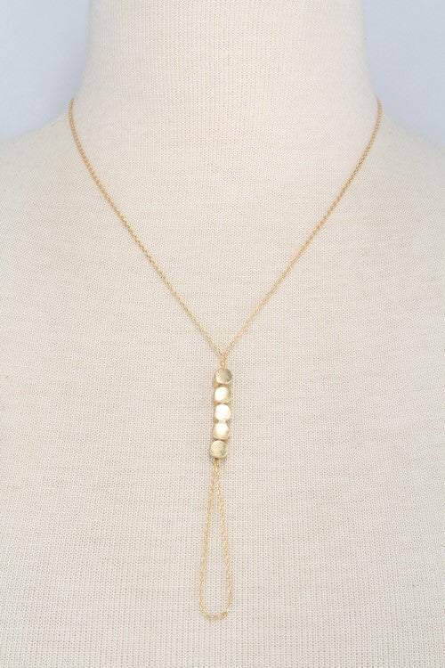 y chain necklace with circular link pendant worn gold
