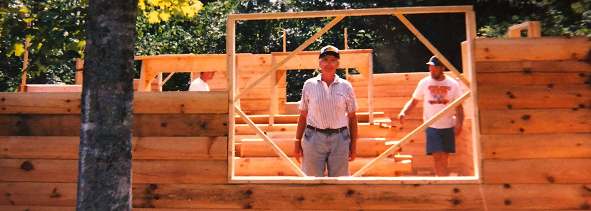 Shawn O'Neill's cabin under construction, with help from his father. Photo courtesy of Shawn O'Neill