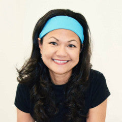 Founder of Qwickbands, Lethi wearing Baby Blue headband (Super Solid Collection)