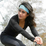 Runner wearing Baby Blue Qwickband