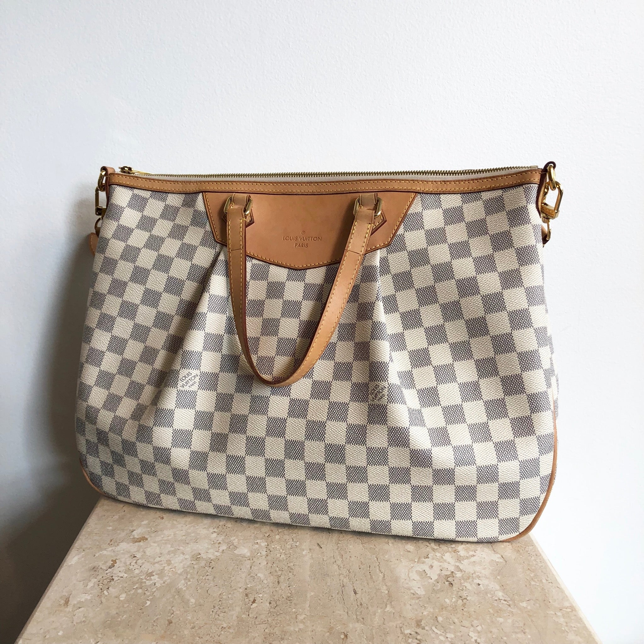 Authentic LOUIS VUITTON Siracusa