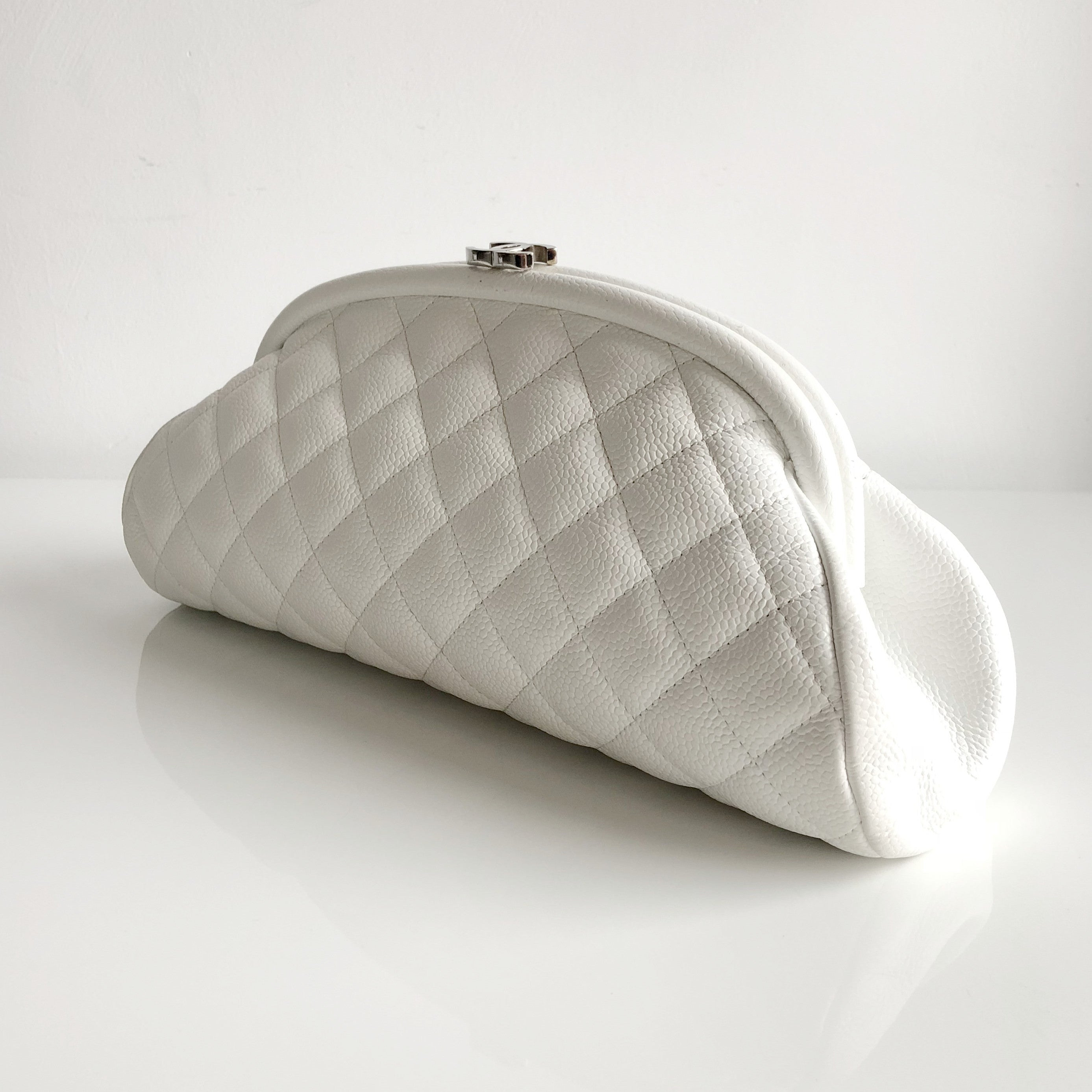 Authentic CHANEL Quilted Timless White Caviar Clutch.
