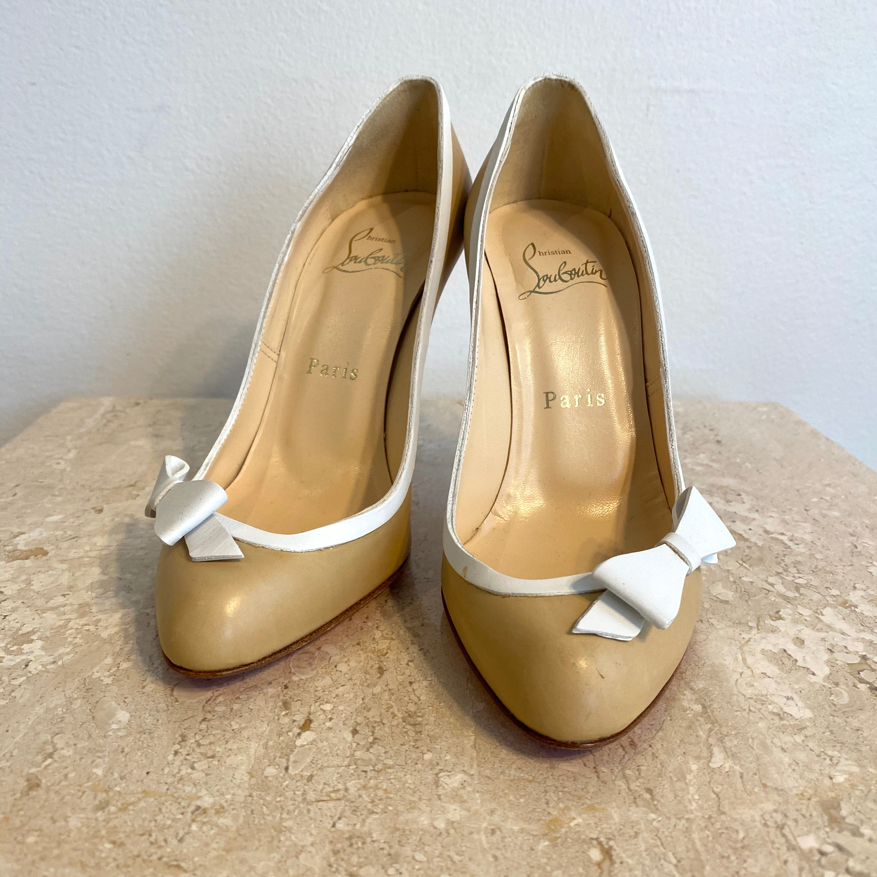 Authentic CHRISTIAN LOUBOUTIN White Bow Pump Size 6